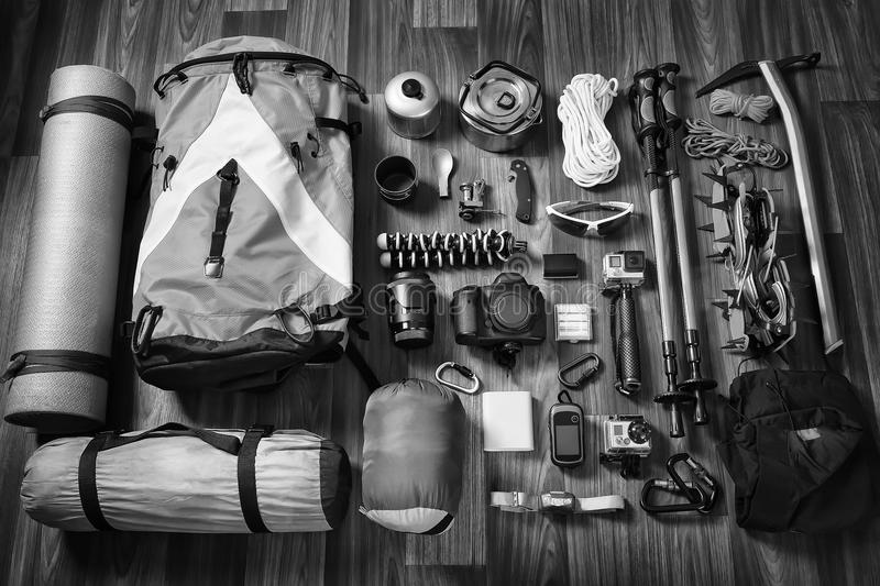 Equipment necessary for mountaineering and hiking on wooden background royalty free stock photo