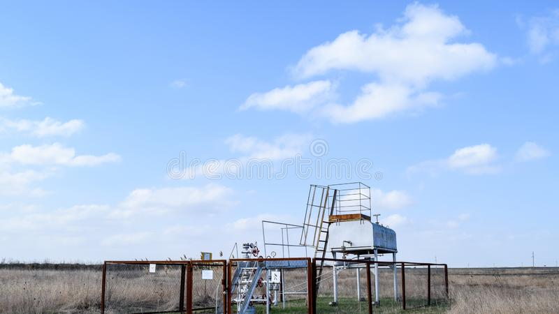 Equipment of an oil well. Shutoff valves and service. Equipment royalty free stock image