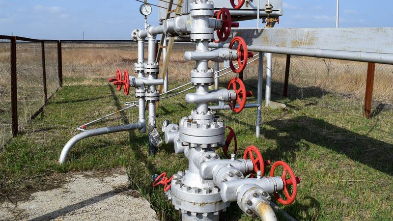 Equipment of an oil well. Shutoff valves and service equipment.  stock photos