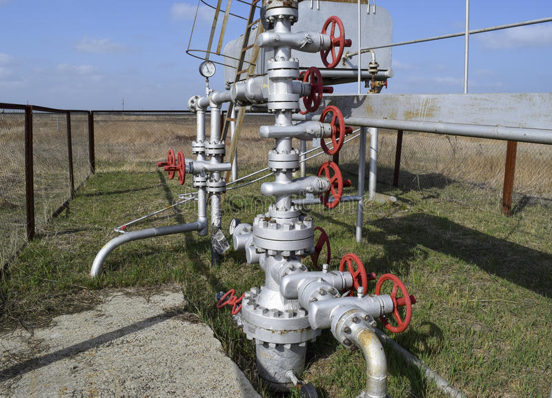 Equipment of an oil well. Shutoff valves and service equipment.  stock image