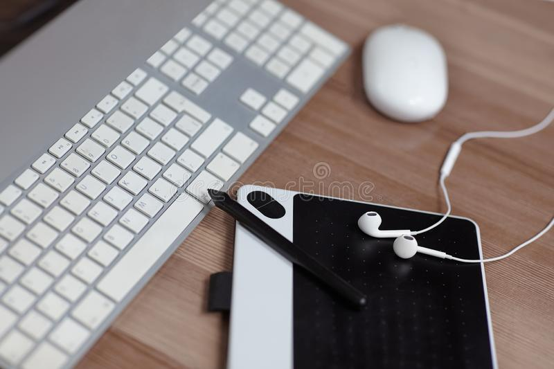The equipment of photographer or grafic designer computer, mouse, grafic tablet, stilus and earphones. Working place of art peop. Le. Outdoors, copy space stock illustration