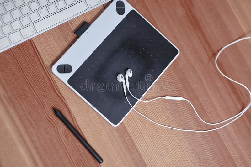 The equipment of photographer or grafic designer computer, mouse, grafic tablet, stilus and earphones. Working place of art peop. Le. Indoors, copy space royalty free illustration