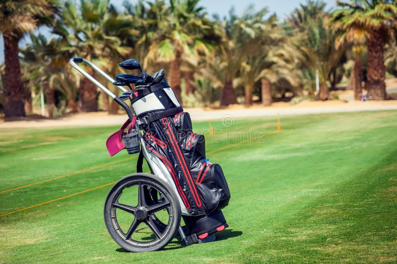 Equipment for playing golf on the green golf field. Equipment for playing golf on the green field royalty free stock photos