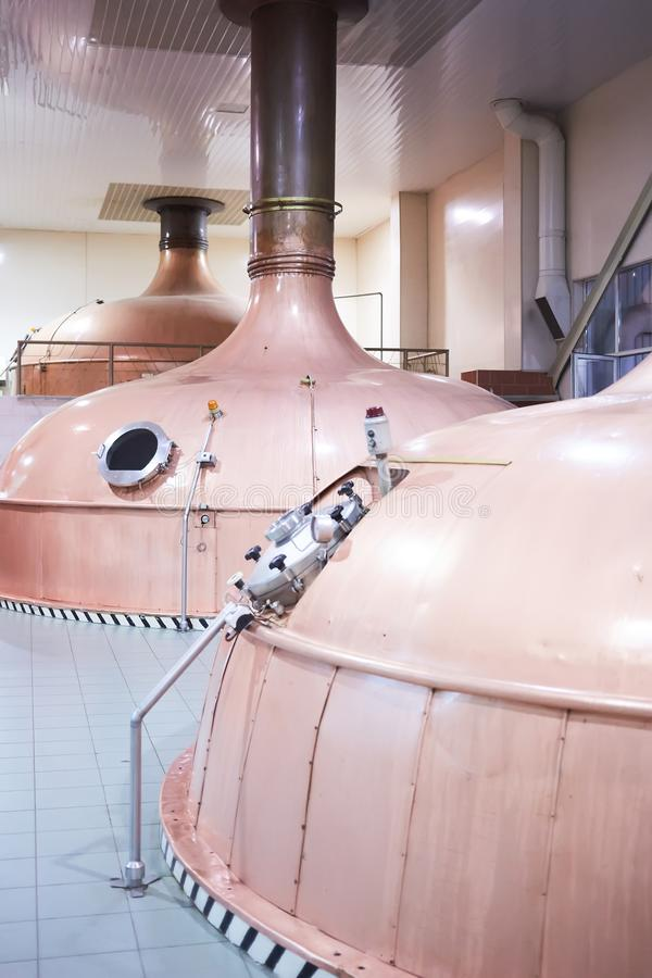 Equipment for preparation of beer. Lines of cooper tanks in brewery. Manufacturable process of brewage. Mode of beer. Production. Inside view of modern stock images