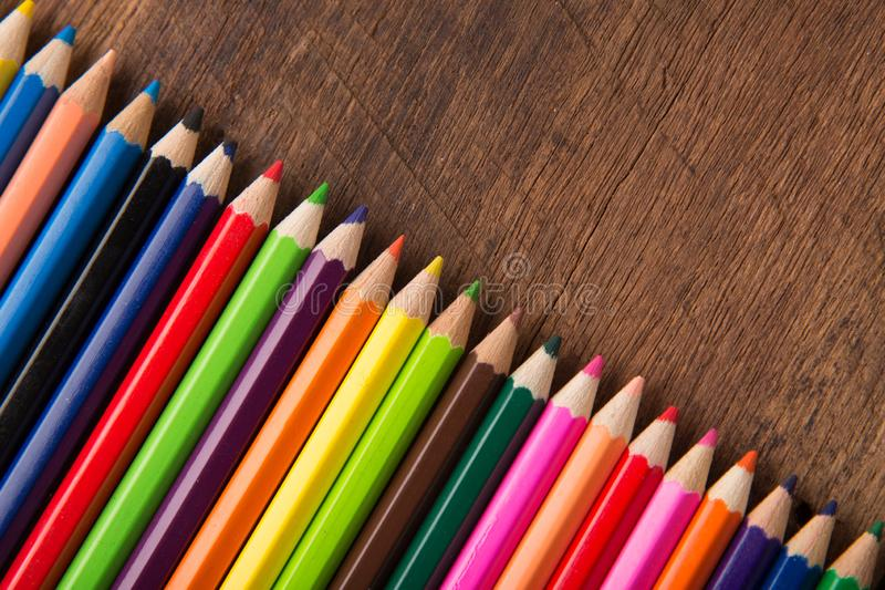 Group of color pencils on the wood table  background color artwork gallery equipment tool concept royalty free stock photography