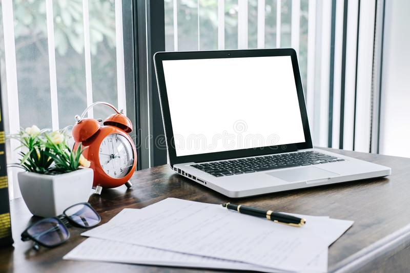Equipment tool of working in home or small office with a laptop and document report on desk as a freelancer.  stock photography