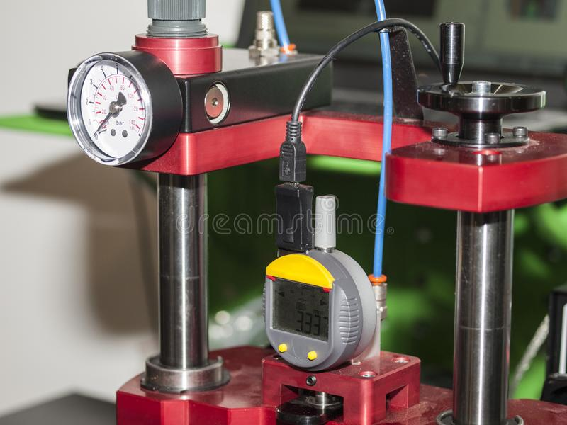 Equipment and tools for diagnostic calibration during maintenance and repair of vehicles. View on green working place with equipment and tools for car trucks royalty free stock photography