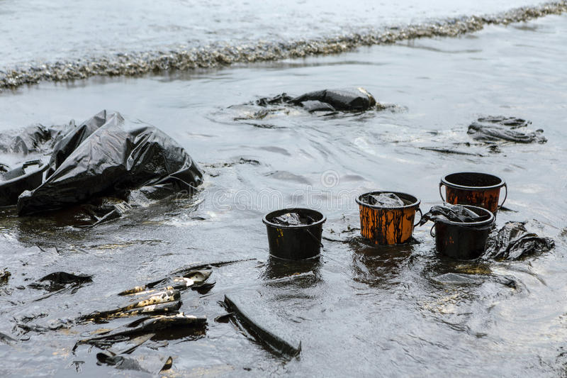 Equipment used to clean oil spill accident. On Ao Prao Beach at Samet island, Thailand royalty free stock photo