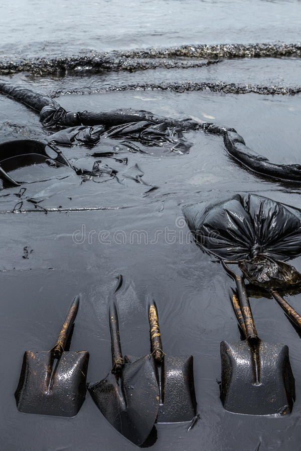 Equipment used to clean oil spill accident. On Ao Prao Beach at Samet island, Thailand stock photos