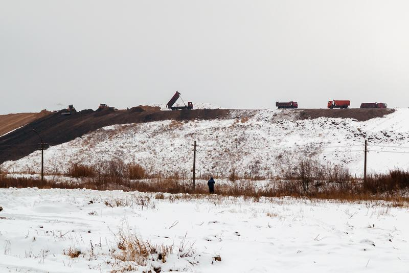 Equipment works in the process of waste disposal and landfill reclamation.  stock photos