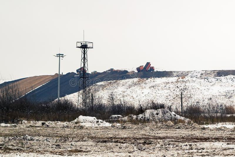 Equipment works in the process of waste disposal and landfill reclamation.  royalty free stock photography