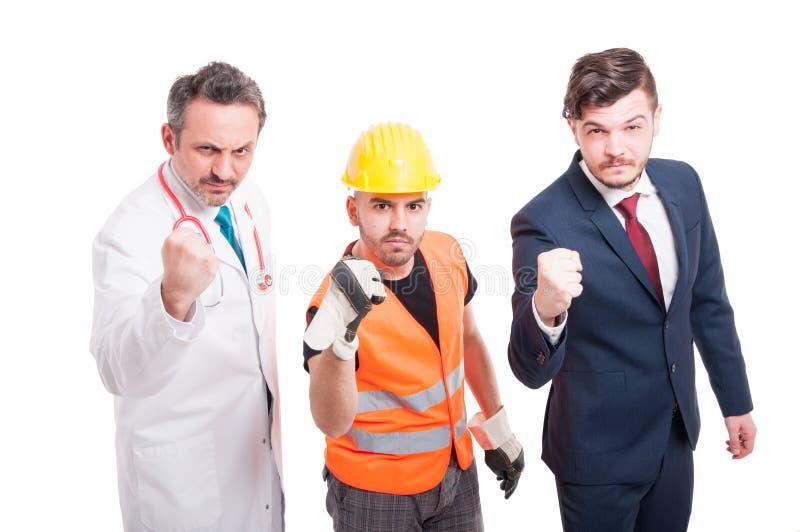 Equipo agresivo de docor, constructor y hombre de negocios imagen de archivo libre de regalías