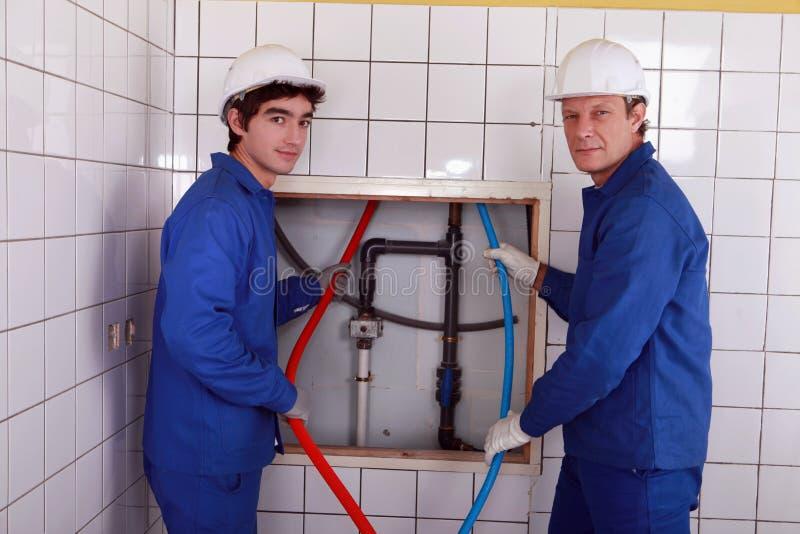 Equipo de fontaneros foto de archivo libre de regalías