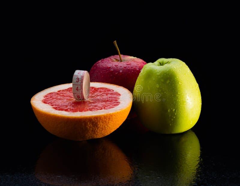 Equipo de la aptitud Alimento sano pomelo, agua, manzana, fresco, clara, frutas foto de archivo