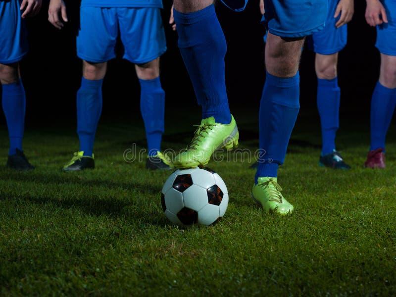 Equipo de los jugadores de fútbol imagen de archivo