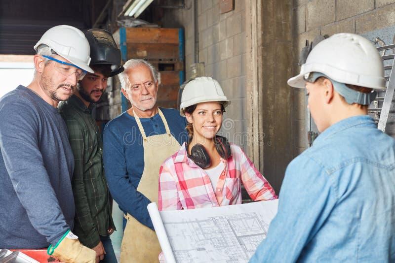 Equipo de trabajadores de cuello azul fotos de archivo