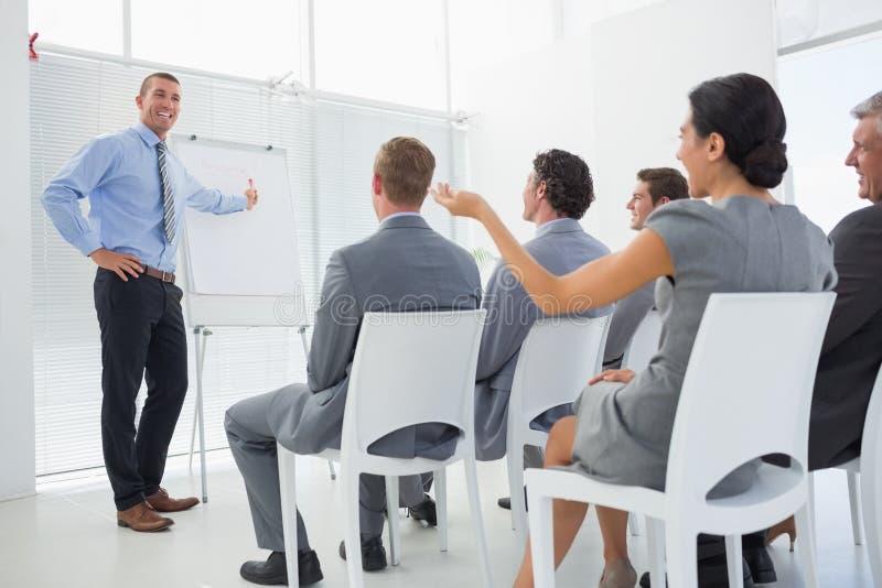 Equipo del negocio durante conferencia imagen de archivo libre de regalías