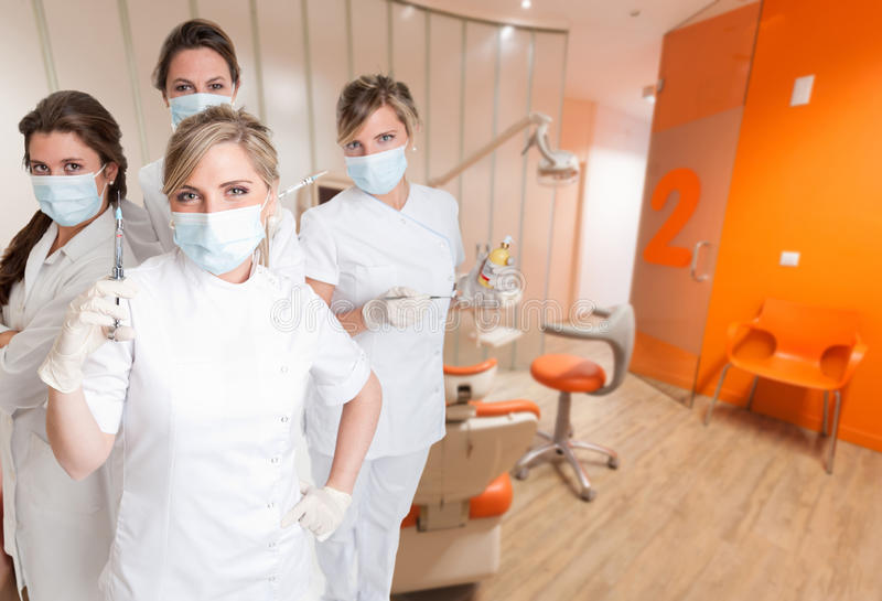 Equipo dental femenino foto de archivo