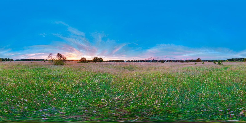 Equirectangular 360虚拟现实背景美好的日出的度球状全景在领域风景蓝天 免版税图库摄影