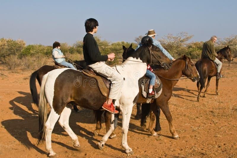 Equitação do grupo fotografia de stock royalty free
