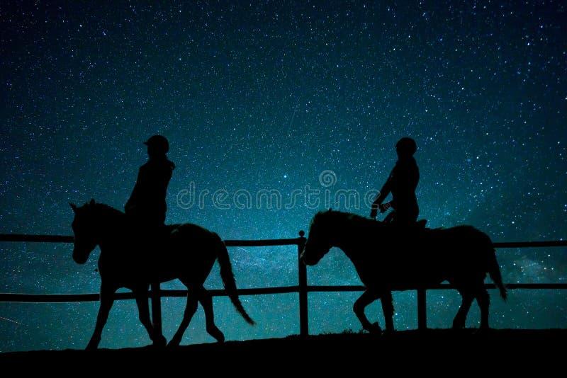 Equitação no universo imagem de stock