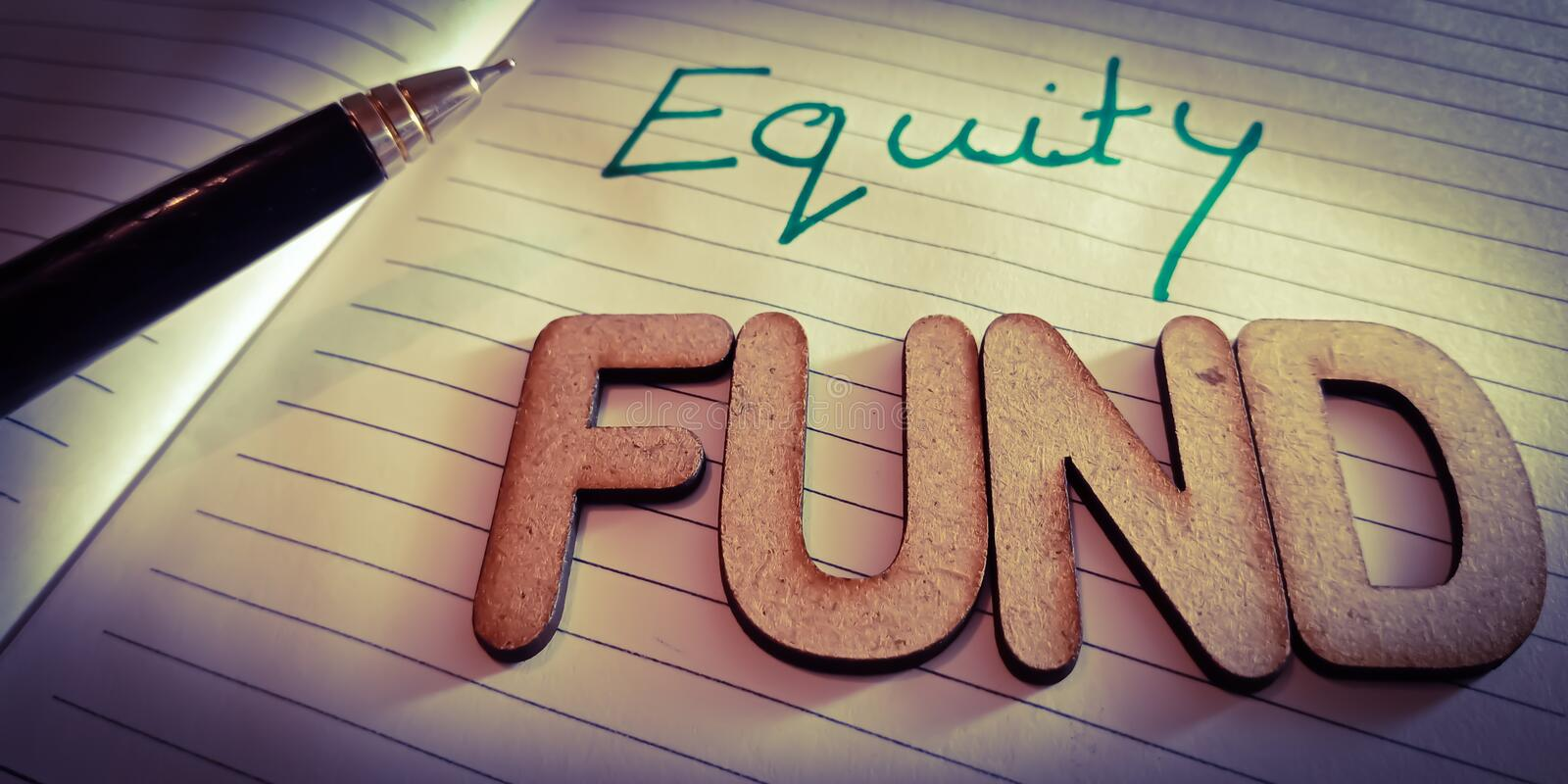 equity fund financial terminology displayed on white paper pen abstract stock photo