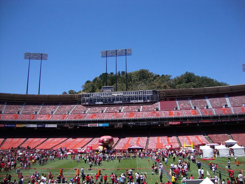 49er football fans explore various activities at FanFest to kick. SAN FRANCISCO, CA - JUNE 12: 49er football fans explore various activities at FanFest to stock photos