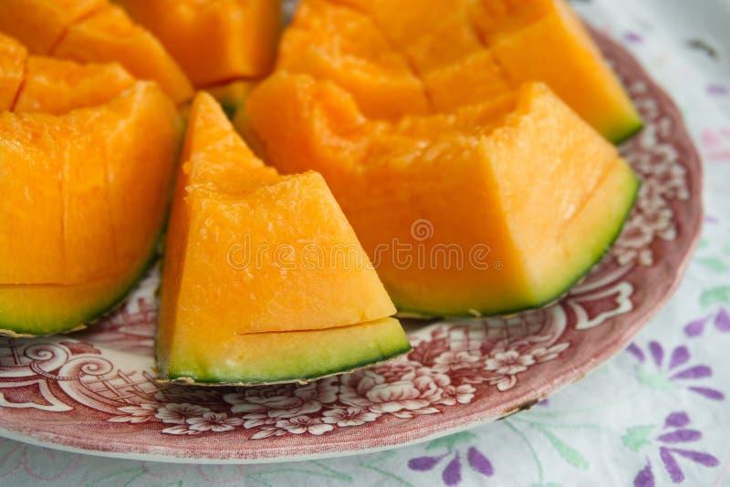 Er zijn de plakken van de Kantaloepmeloen is op de lijst stock afbeeldingen
