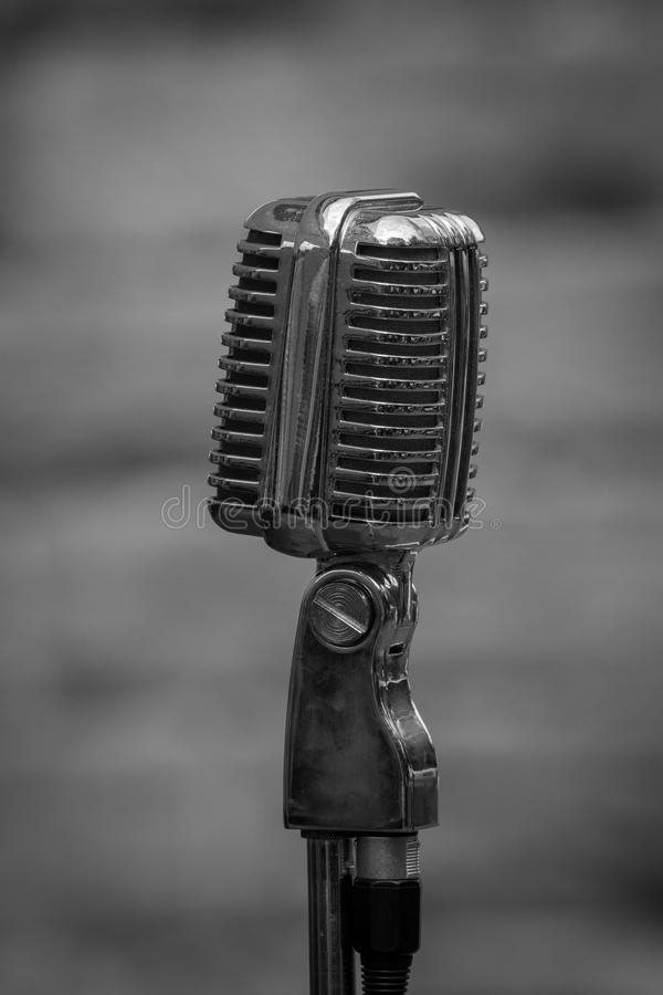 1940 era microphone. 1940 ear microphone in black and white. A photograph of an early microphone in upright vertical format royalty free stock image
