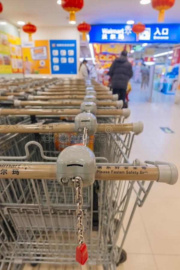 In the era of online shopping, many shopping carts are parked at the entrance of wal-mart stores in China. Wal Mart Department Store Co., Ltd. is a worldwide stock photos