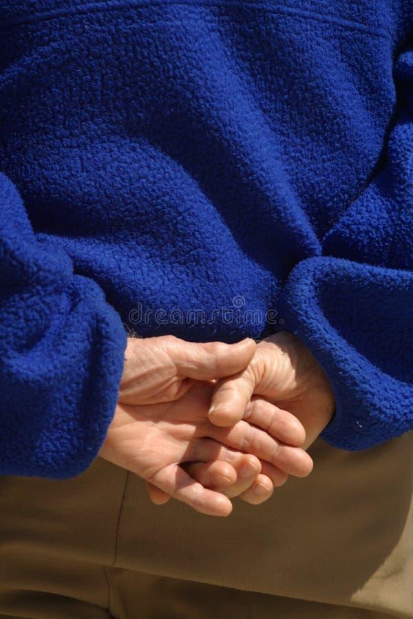 Erachter gevouwen handen. 2 royalty-vrije stock afbeelding