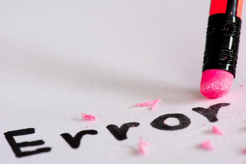 Erase the word Error with a rubber concept of eliminating. The error, mistake. closeup of a pencil erasing an `error royalty free stock photography