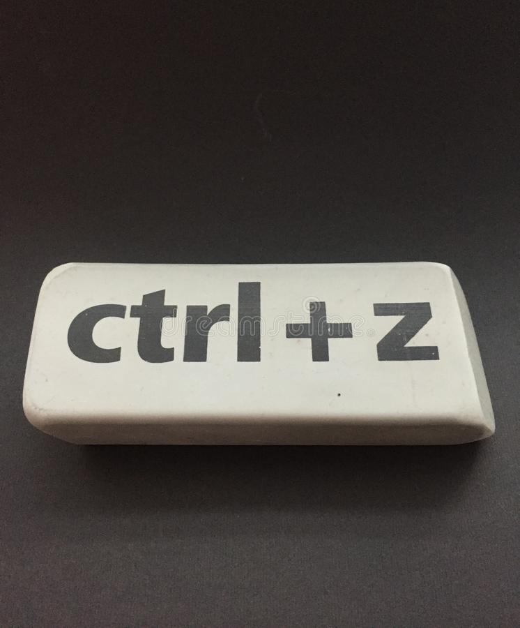 Eraser with the inscription & x22;ctrl + z& x22; on a black background. Education, key, school, space, gray, arts, backgrounds, blackboard, blank, class royalty free stock image