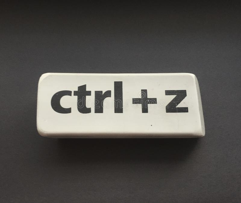 Eraser with the inscription & x22;ctrl + z& x22; on a black background. Education, key, school, space, gray, arts, backgrounds, blackboard, blank, class stock image