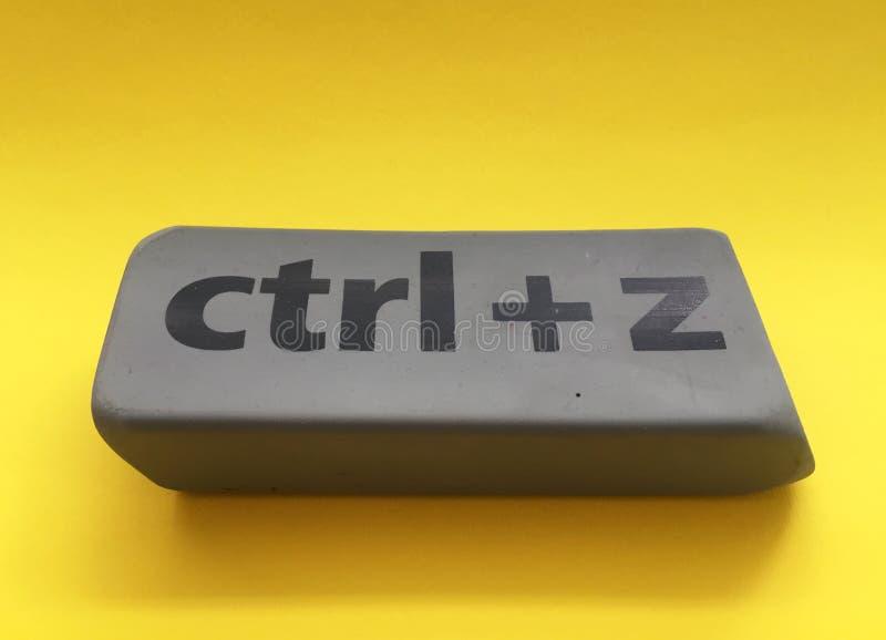 Eraser with the inscription & x22;ctrl + z& x22; on a yellow background. Black, education, key, school, gray, arts, backgrounds, blackboard, blank, class stock photo