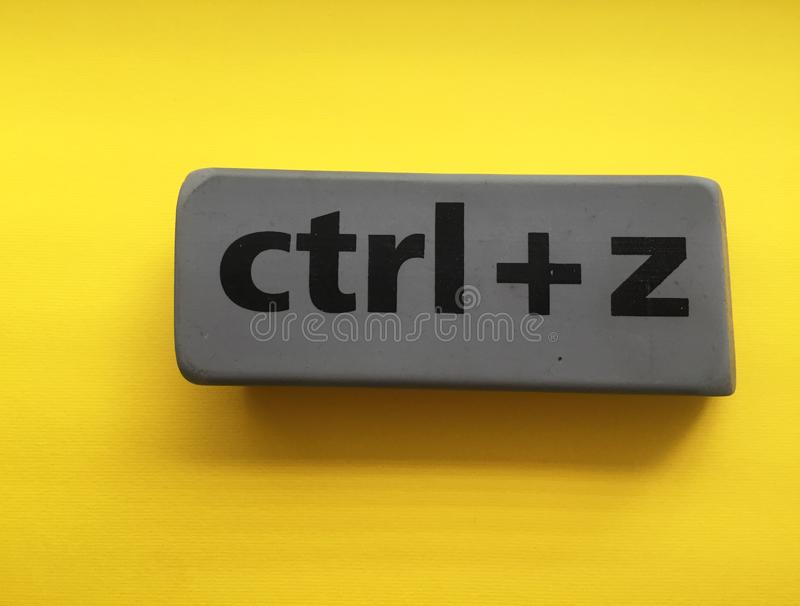 Eraser with the inscription & x22;ctrl + z& x22; on a yellow background. Isolated, black, education, key, school, gray, arts, backgrounds, blackboard, blank royalty free stock photo