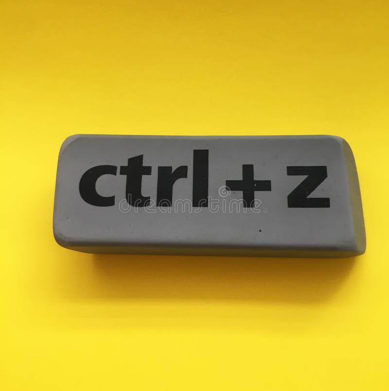 Eraser with the inscription & x22;ctrl + z& x22; on a yellow background. Isolated, black, education, key, school, gray, arts, backgrounds, blackboard, blank stock image