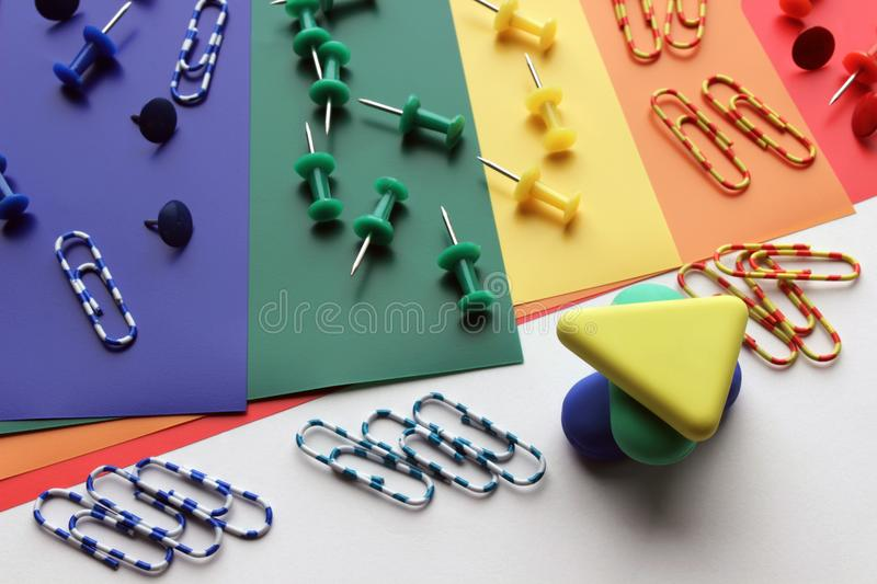Erasers and paper clips stock photos
