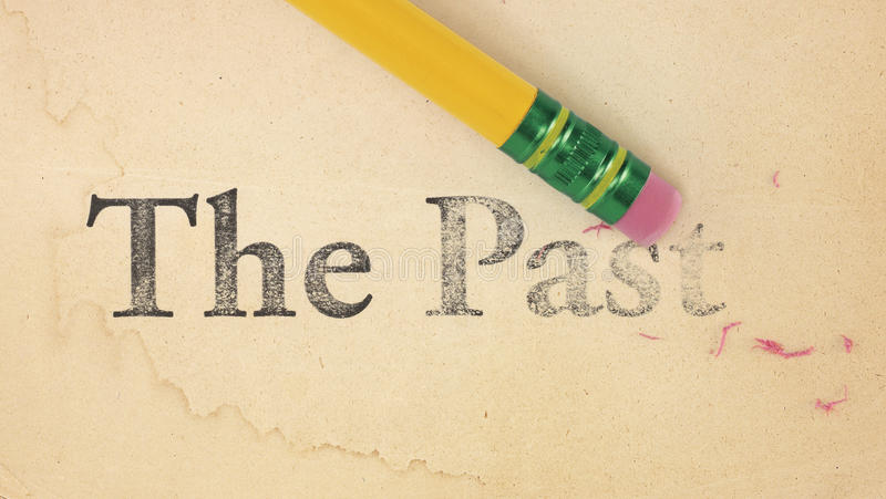 Erasing The Past. Close up of a yellow pencil erasing the words, 'The Past' from old, yellowed paper royalty free stock photos