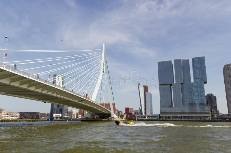 Erasmus suspension bridge crossing busy new Maas river with modern buildings on other side stock photo