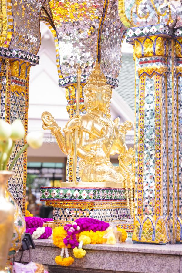 The Erawan Shrine. Famous tourist attraction in Bangkok, Thailand. The Erawan Shrine. Or formally known as the Thao Maha Phrom Shrine, one of tourist attractions stock images