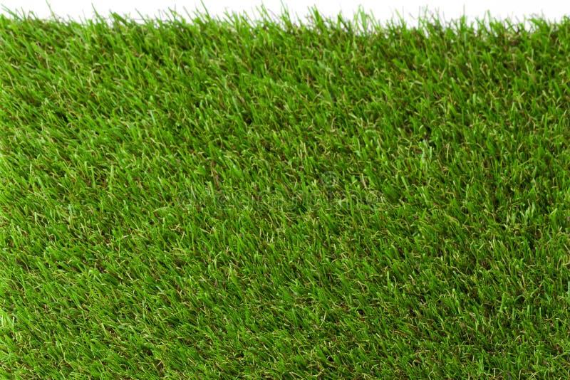 erba artificiale sul campo di calcio, fondo artificiale verde di strutture dell'erba immagine stock