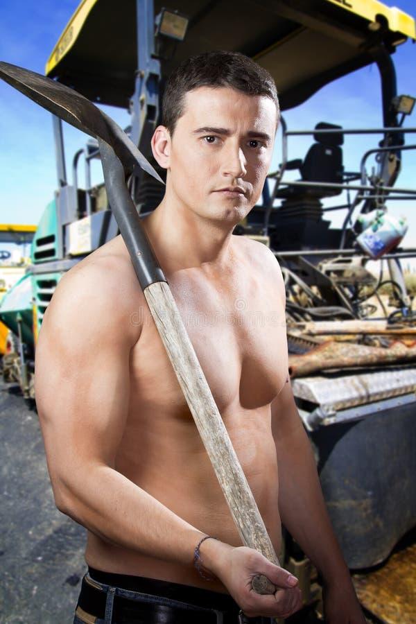 Erbauer auf sphalting Straßenbetoniermaschinemaschine stockbild
