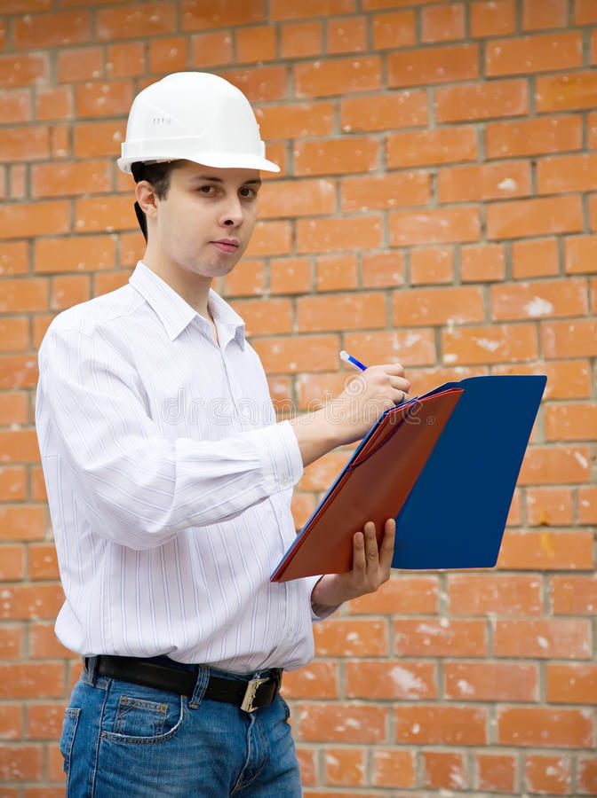 Erbauer mit Dokumenten stockfoto
