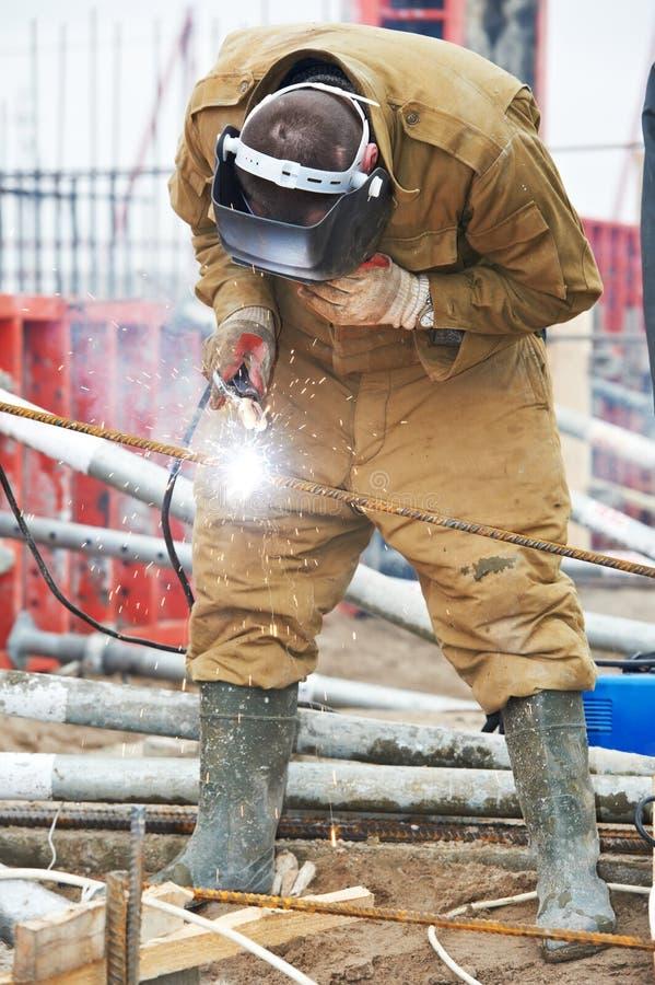 Erbauerarbeitskraft wellder bei der Arbeit stockfotografie