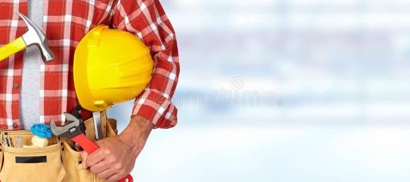 Erbauerheimwerker mit Bauwerkzeugen stockbilder