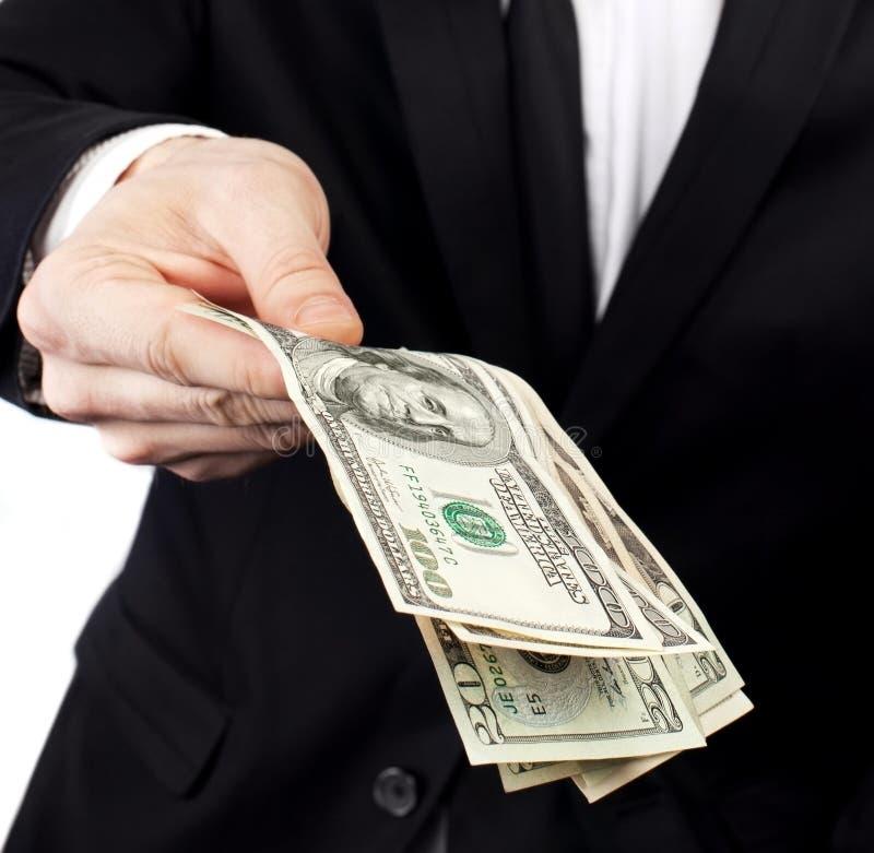 erbjuda för affärsmanpengar arkivfoton