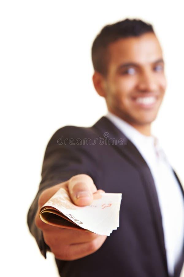 erbjuda för manpengar arkivbilder