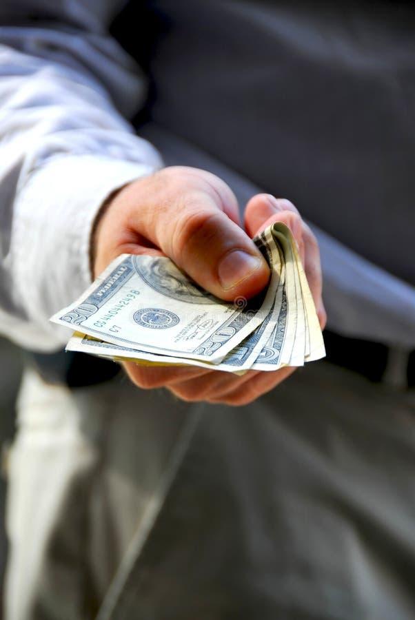 erbjudande för handpengar arkivbild