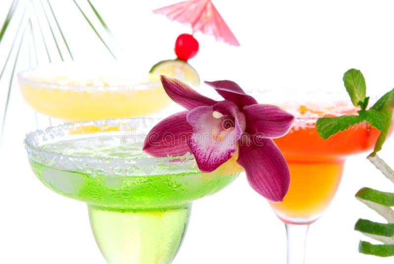 Erdbeere; Kalk und orange Margaritascocktails lizenzfreies stockbild